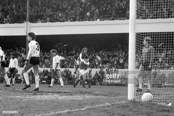 Arsenal's Graham Rix rises above Tony Woodcock as they give a congratulatory hug to Charlie Nicholas after his goal The Notts County players can only...