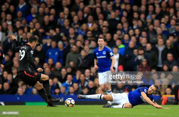 Arsenal's Granit Xhaka and Everton's Nikola Vlasic battle for the ball during the Premier League match at the Goodison Park Liverpool