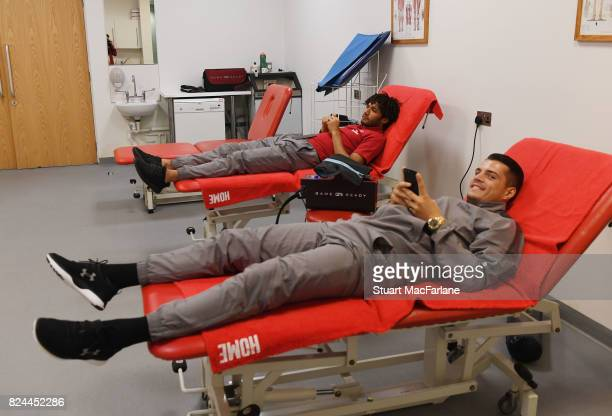 Arsenal's Granit Xhaka and Mohamed Elneny relax in the home changing room before the Emirates Cup match between Arsenal and Seville at Emirates...