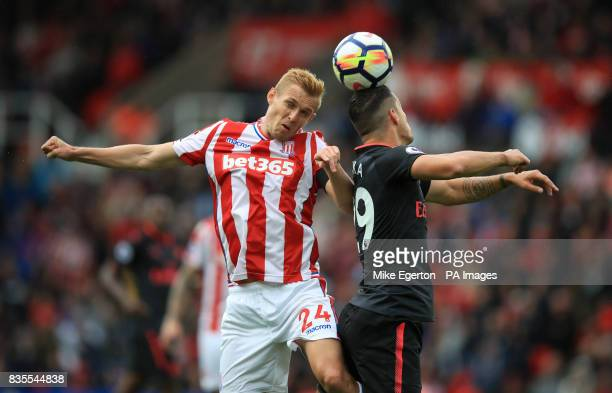 Arsenal's Granit Xhaka and Stoke City's Darren Fletcher battle for the ball during the Premier League match at the bet365 Stadium Stoke