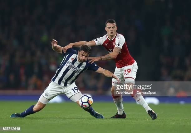 Arsenal's Granit Xhaka and West Bromwich Albion's Jay Rodriguez during the Premier League match between Arsenal and West Bromwich Albion at Emirates...