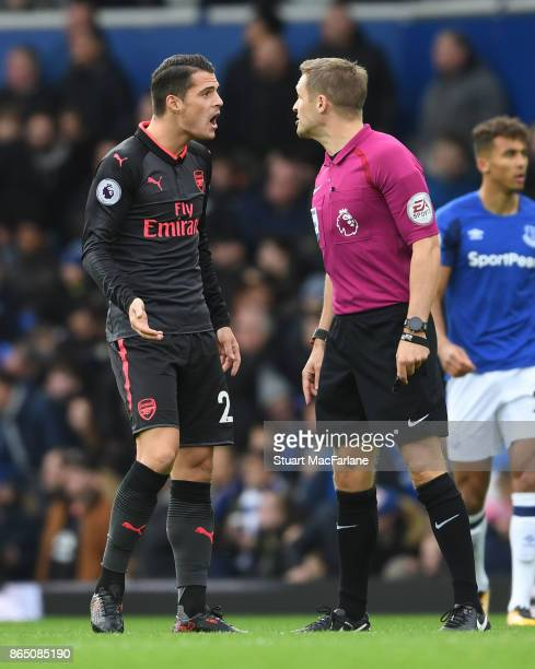 Arsenal's Granit Xhaka conplains to referee Craig Pawson after the Everton goal during the Premier League match between Everton and Arsenal at...