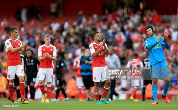Arsenal's Granit Xhaka Francis Coquelin and Petr Cech acknowledge the fans after the final whistle