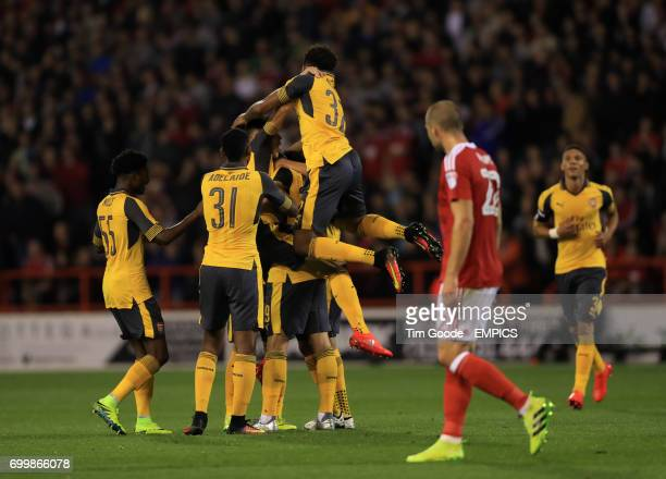 Arsenal's Granit Xhaka ismobbed by teammates after scoring his side's first goal of the game