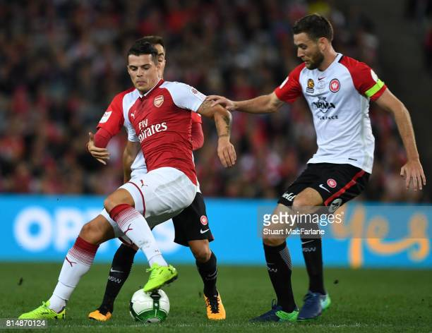 Arsenal's Granit Xhaka takes on Robert Cornthwaite of Sydney Wanderers during the match between the Western Sydney Wanderers and Arsenal FC at ANZ...