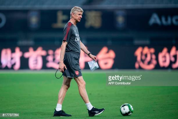 Arsenal's head coach Arsene Wenger attends a training session ahead of the International Champions Cup football match between Bayern Munich and...