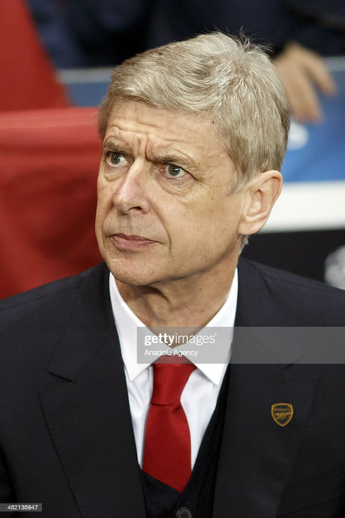 Arsenal's head coach Arsene Wenger during the UEFA Champions League group F football match between Arsenal and Olympique de Marseille at the Emirates Stadium on November 26, 2013 in London, England.