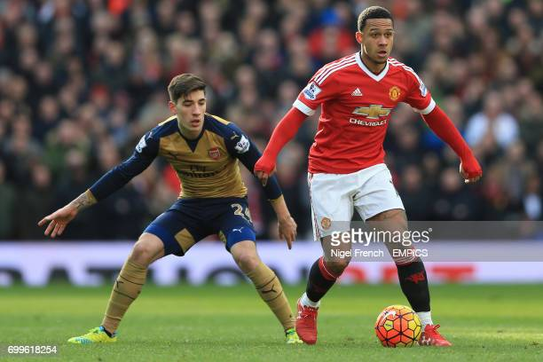 Arsenal's Hector Bellerin and Manchester United's Memphis Depay battle for the ball