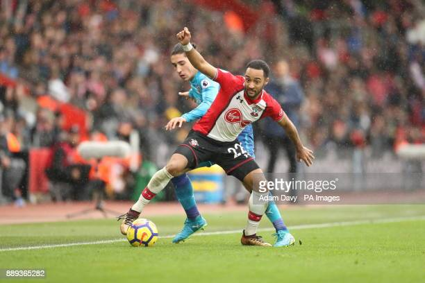 Arsenal's Hector Bellerin and Southampton's Ryan Bertrand battle for the ball during the Premier League match at St Mary's Stadium Southampton