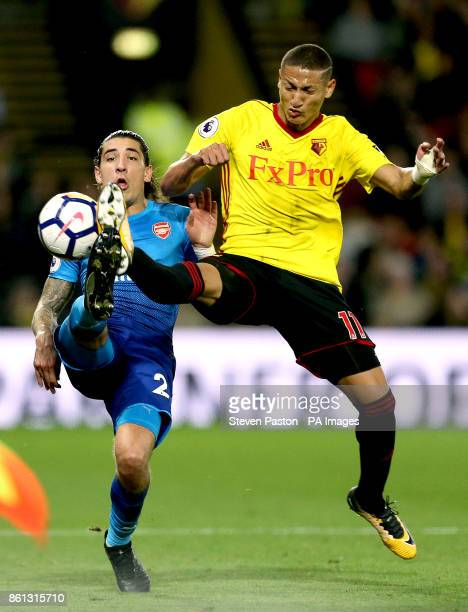 Arsenal's Hector Bellerin and Watford's Richarlison battle for the ball during the Premier League match at Vicarage Road Watford