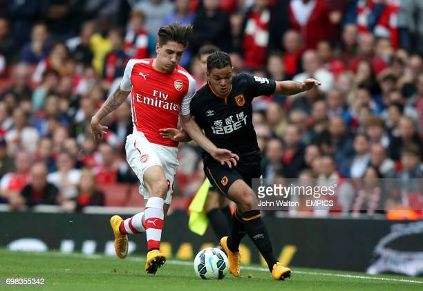 Arsenal's Hector Bellerin battles for possession of the ball with Hull City's Hatem Ben Arfa