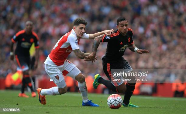 Arsenal's Hector Bellerin battles for possession of the ball with Manchester United's Memphis Depay