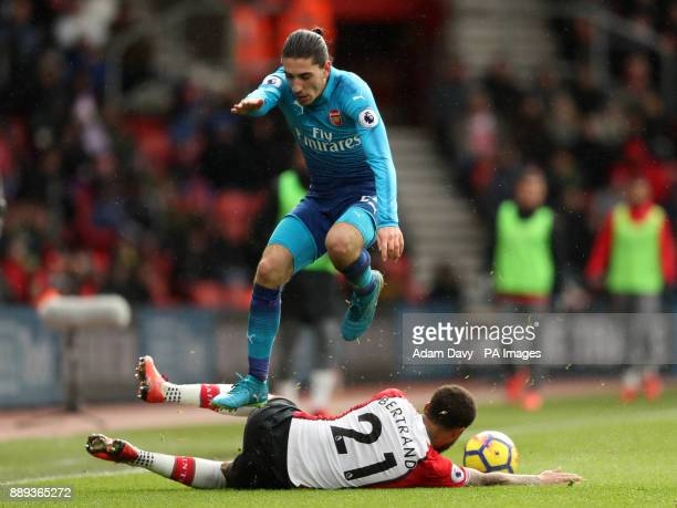 Arsenal's Hector Bellerin jumps over Southampton's Ryan Bertrand during the Premier League match at St Mary's Stadium Southampton