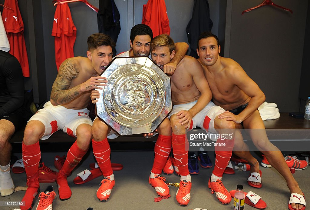 (L-R0 Arsenal's Hector Bellerin, Mikel Arteta, Nacho Monreal and Santi Cazorla celebrate after the FA Community Shield match between Chelsea and Arsenal at Wembley Stadium on August 2, 2015 in London, England.