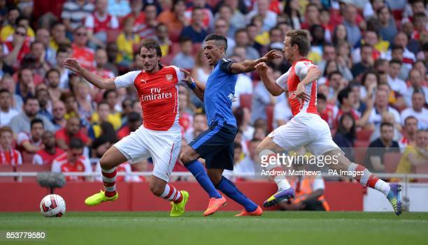 Arsenal's Ignasi Miguel and Nacho Monreal battle for the ball with AS Monaca FC's Nabil Dirar during the Emirates Cup match at The Emirates Stadium...