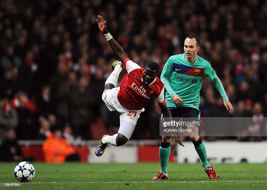 Arsenal's Ivorian defender Emmanuel Eboue (L) vies with Barcelona's Spanish midfielder Andres Iniesta (R) during their UEFA Champions League round of 16, 1st leg football match against Barcelona at the Emirates Stadium, London, England, on February 16, 2011.