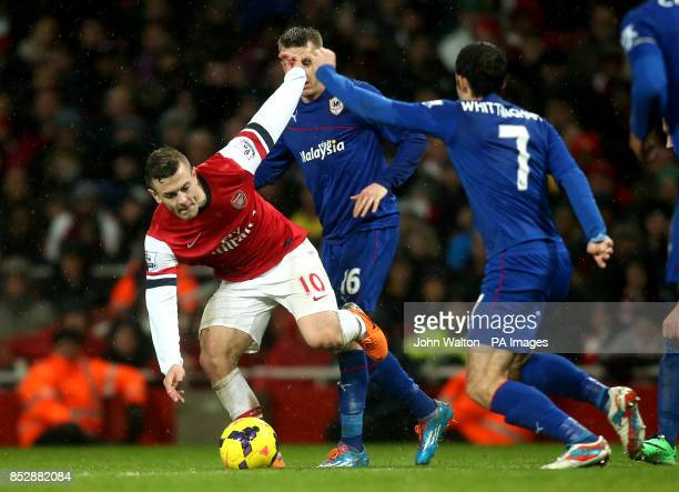 Arsenal's Jack Wilshere and Cardiff City's Peter Whittingham battles for possession of the ball during the Barclays Premier League match at the...