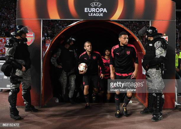 Arsenal's Jack Wilshere and Francis Coquelin walk out of the players tunnel for the warm up before the UEFA Europa League group H match between...