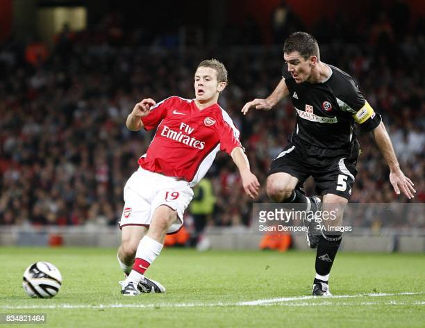 Arsenal's Jack Wilshere and Sheffield United's Chris Morgan in action
