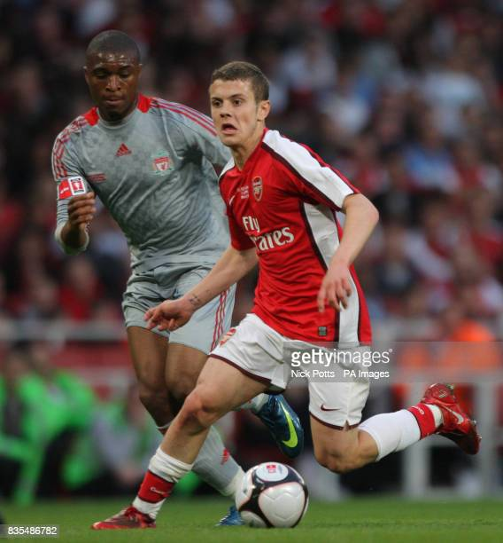 Arsenal's Jack Wilshere holds off challenge from Liverpool's David Amoo during the FA Youth Cup Final First Leg at the Emirates Stadium London