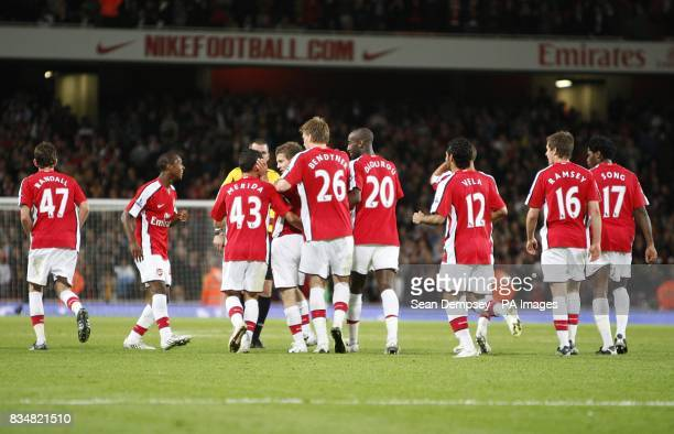 Arsenal's Jack Wilshere is congratulated by his team mates after scoring the fifth goal