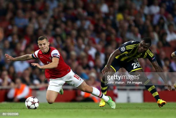 Arsenal's Jack Wilshere is sent flying under the challenge of Fenerbache's Emmanuel Emenike during the UEFA Champions League PlayOff Round Second Leg...