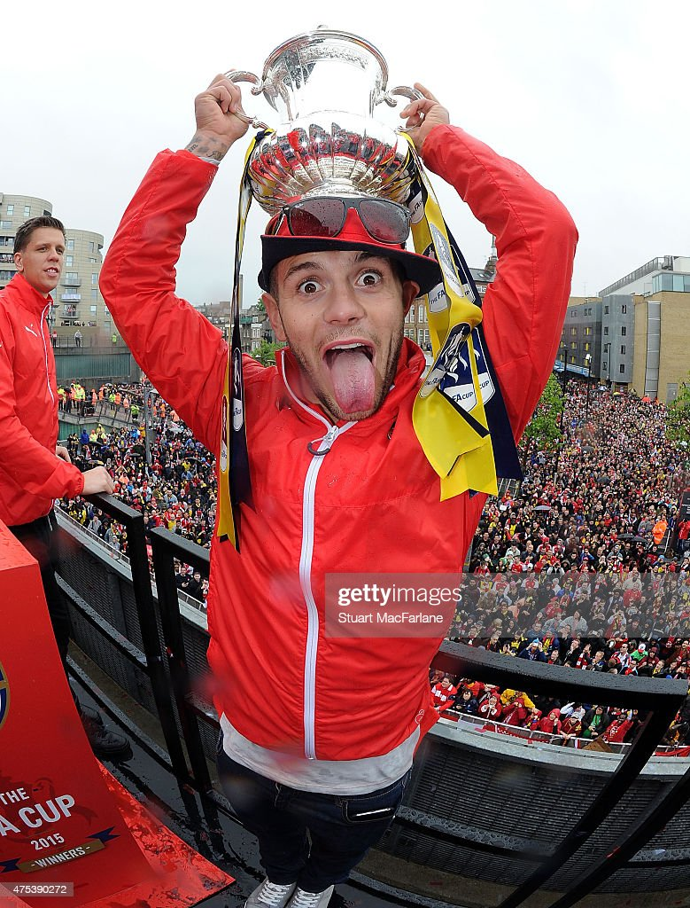 Arsenal's <a gi-track='captionPersonalityLinkClicked' href=/galleries/search?phrase=Jack+Wilshere&family=editorial&specificpeople=5446655 ng-click='$event.stopPropagation()'>Jack Wilshere</a> poses with the cup during the Arsenal FA Cup Victory Parade in Islington on May 31, 2015 in London, England.