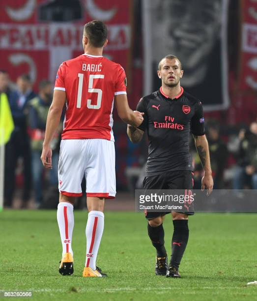 Arsenal's Jack Wilshere shakes hands with Red Star defender Srdan Babic after the UEFA Europa League group H match between Crvena Zvezda and Arsenal...