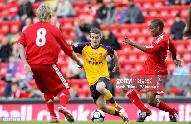 Arsenals Jack Wilshere skips past Liverpool's Andre Wisdom and Christoper Butchtman during the FA Youth Cup Final First Leg at the Emirates Stadium...