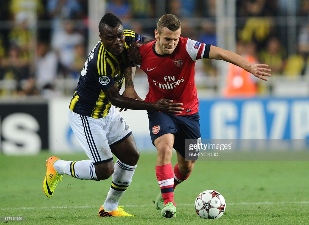 Arsenal's Jack Wilshere (R) vies for the ball with Fenerbahce's Emmanuel Emenike (L) during their UEFA Champions League Play Off first leg match at Sukru Saracoglu Stadium in Istanbul on August 21, 2013. AFP PHOTO/BULENT KILIC