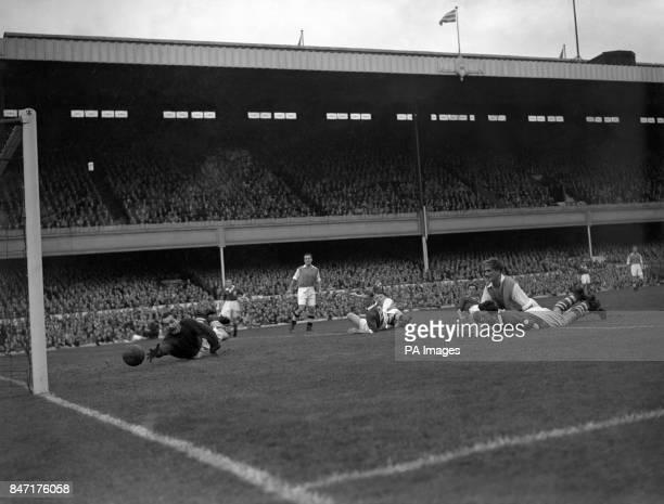 Arsenal's James Logie scores past Birmingham City goalkeeper Gil Merrick