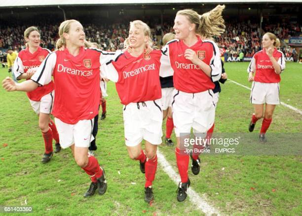 Arsenal's Jayne Ludlow Carol Harwood and Kirsty Pealling celebrate victory