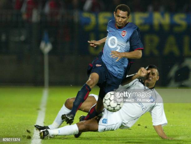 Arsenal's Jermaine Pennant is tackled by Auxerre's Jean Sebastien Jaures during their Champions League Group A match at the Stade Abbe Deschamps...