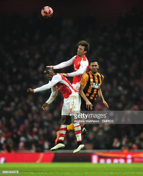 Arsenal's Joel Campbell and Nacho Monreal battle for the ball with Hull City's Ahmed Elmohamady