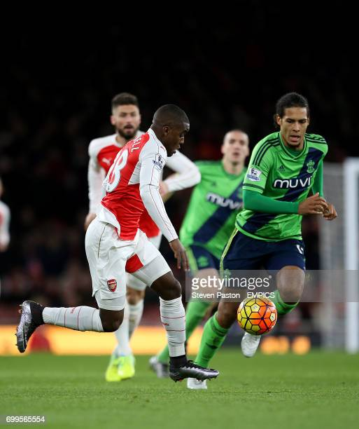 Arsenal's Joel Campbell and Southampton's Virgil van Dijk battle for the ball