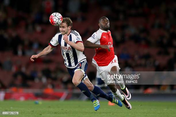 Arsenal's Joel Campbell and West Bromwich Albion's Craig Dawson battle for the ball