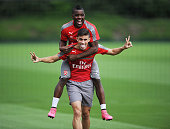 Arsenal's Joel Campbell jumps on Gabriel's back before a training session at London Colney on July 15 2016 in St Albans England
