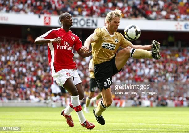 Arsenal's Johan Djourou and Juventus' Pavel Nedved