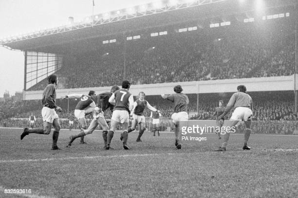Arsenal's John Radford fires home his team's goal watched by teammates George Armstrong and Ray Kennedy