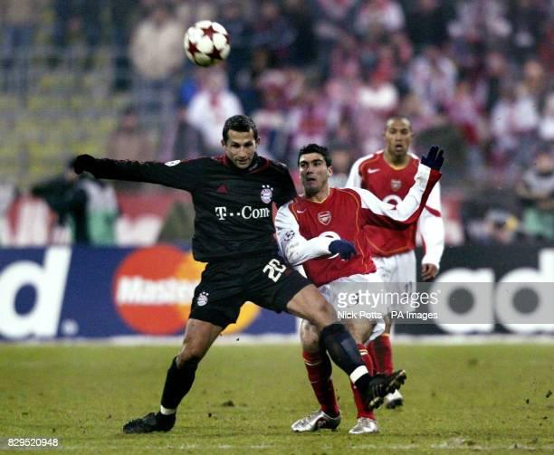 Arsenal's Jose Antonio Reyes tussles with Bayern Munich's Hasan Salihamidzic