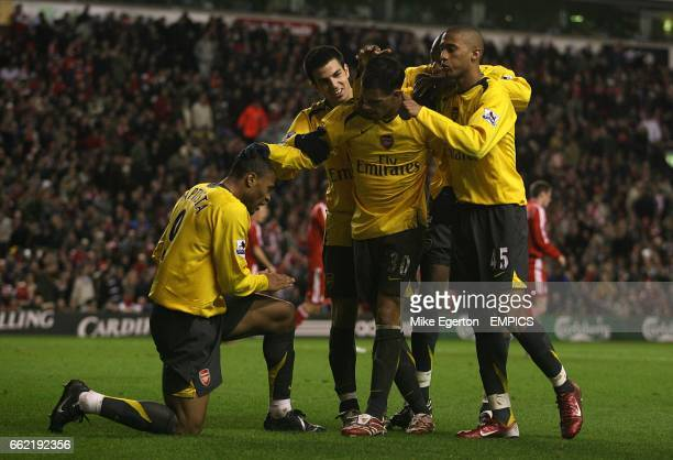 Arsenal's Julio Baptista celebrates his fourth goal by bowing down at the feet of Jeremie Aliadiere who set him up