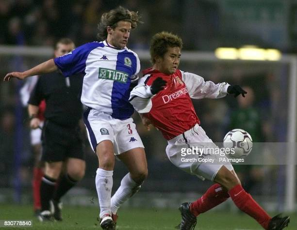 Arsenal's Junichi Inamoto holds off Blackburn's Tugay during the Worthington Cup Quarter Final match at Ewood Park THIS PICTURE CAN ONLY BE USED...