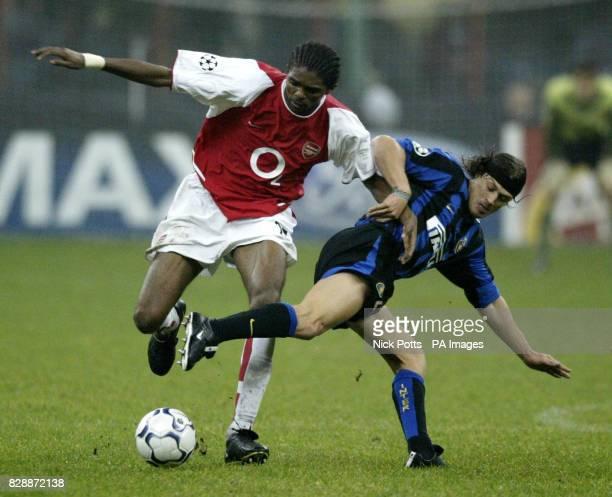 Arsenal's Kanu tussles with Inter Milan's Matias Almeyda during Arsenal's 51 win during their UEFA Champions League Group B game at San Siro Milan...