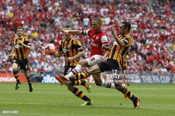 Arsenal's Kieran Gibbs and Hull City's Ahmed Elmohamady battle for the ball