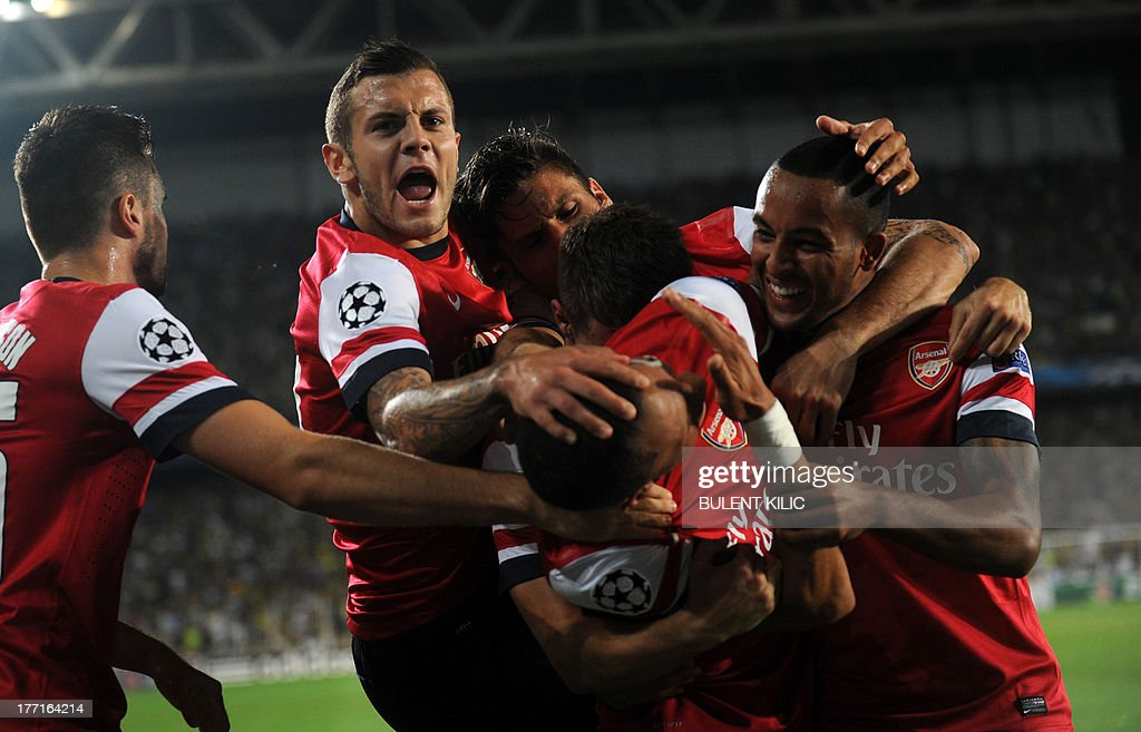 Arsenal's Kieran Gibbs (C) celebrates with team mates after scoring against Fenerbahce during their UEFA Champions League Play Off first leg match at Sukru Saracoglu Stadium in Istanbul on August 21, 2013. AFP PHOTO/BULENT KILIC