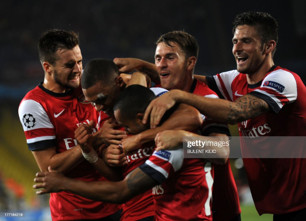 Arsenal's Kieran Gibbs (2L) celebrates with team mates after scoring against Fenerbahce during their UEFA Champions League Play Off first leg match at Sukru Saracoglu Stadium in Istanbul on August 21, 2013. AFP PHOTO/BULENT KILIC