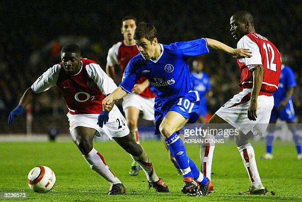 Arsenal's Kolo Toure and Lauren vie for the ball with Chelsea's Joe Cole during their Champions League quarterfinal second leg football match 06...