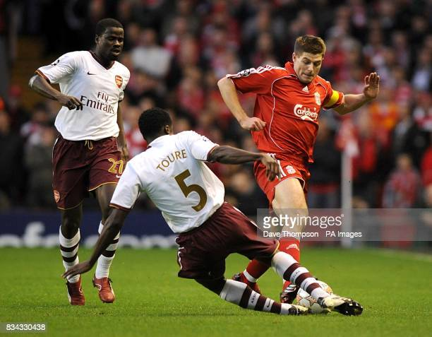 Arsenal's Kolo Toure and Liverpool's Steven Gerrard battle for the ball