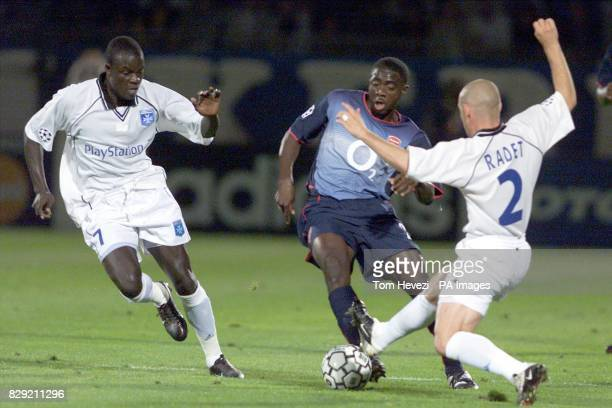 Arsenal's Kolo Toure tries to squeeze between Auxerre's Amdy Faye and Johan Radet during their Champions League Group A match at the Stade Abbe...