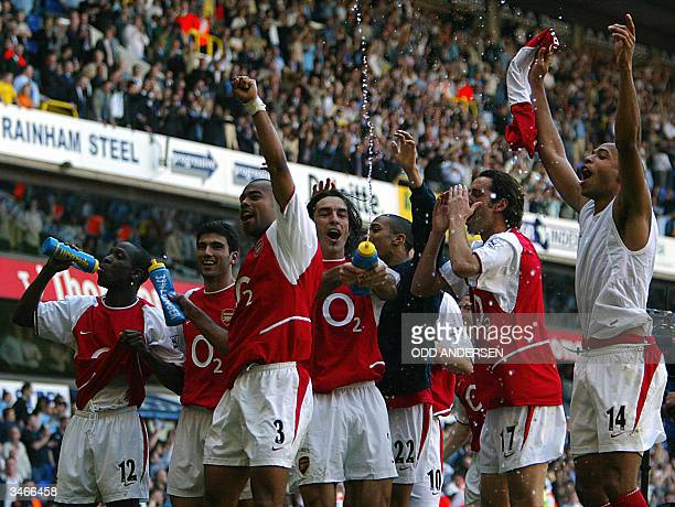 Arsenal's L to R Lauren Jose Antonio Reyes Ashley Cole Robert Pires Edu and Thierry Henry celebrates winning the 2003/2004 Football Premier League...